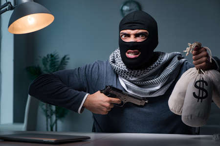 Terrorist burglar with gun asking for money ransom Imagens