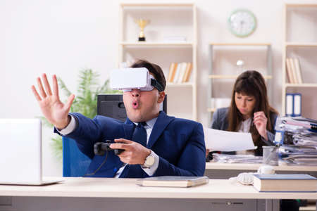 Employee with virtual reality glasses in office
