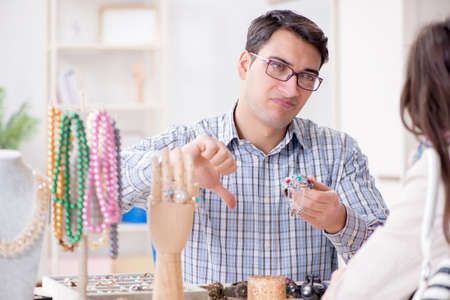 Woman visiting jeweler for jewelery evaluation Stock Photo