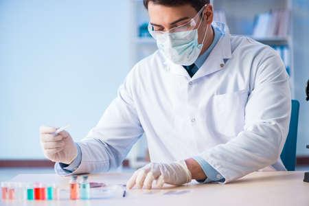 Lab assistant testing blood samples in hospital