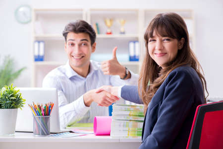 Pulisher discussing book order with customer Stock Photo