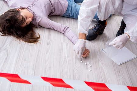 Forensic investigator at the crime scene investigating woman mur Stock Photo - 100956317