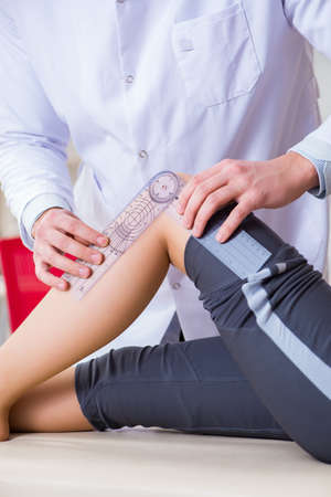 Doctor checking patients joint flexibility 写真素材