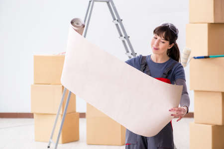 Woman preparing for wallpaper work