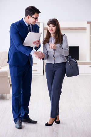 Real estate agent showing new apartment to owner Archivio Fotografico