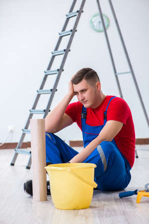 Contractor worker preparing for wallpaper decoration