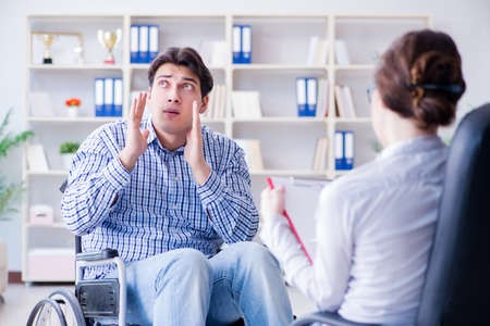 Patient visiting psychotherapist to deal with consequences of tr