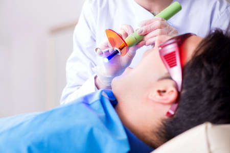 Patient visiting dentist for regular check-up and filling Imagens