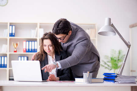 Sexual harassment concept with man and woman in office Stock Photo - 101605103