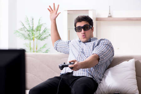 Man playing 3d games at home