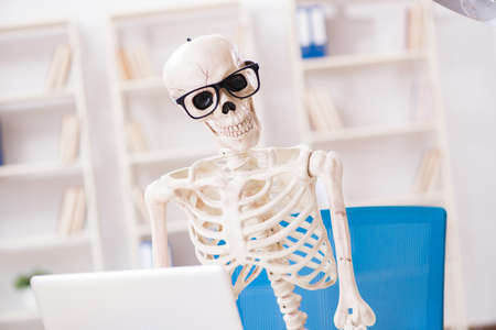 Skeleton businessman working in the office Stock Photo