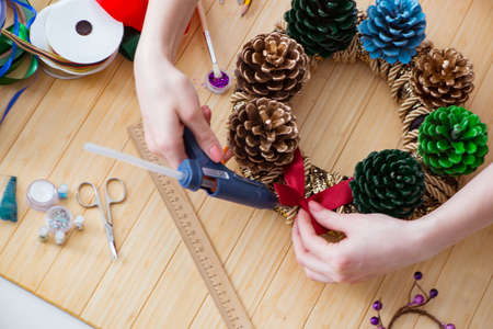 Woman doiing DIY festive decorations at home Reklamní fotografie