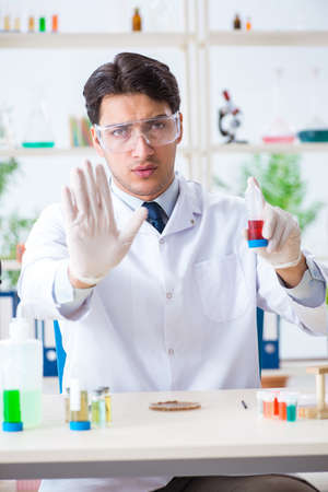 Male Biochemist Working In The Lab On Plants Stock Photo, Picture ...