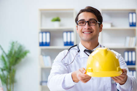 Safety doctor advising about wearing hard hat