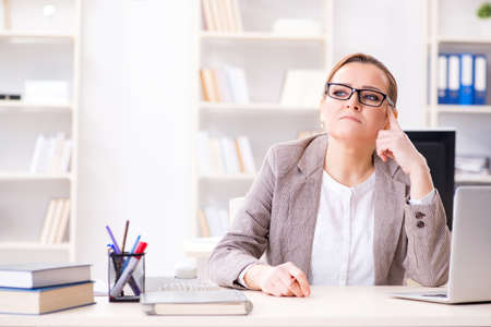 Businesswoman employee working in the office