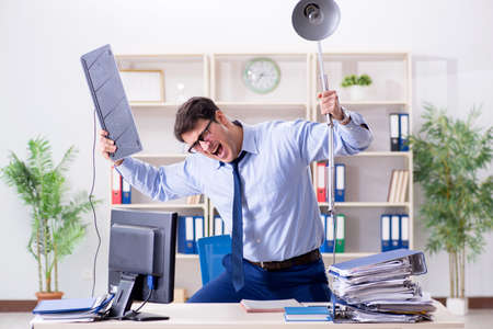 Angry businessman frustrated with too much work Archivio Fotografico