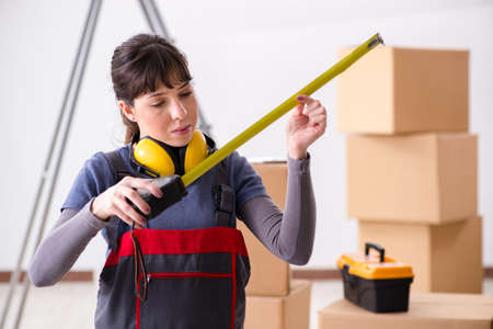 Woman contractor with measuring tape