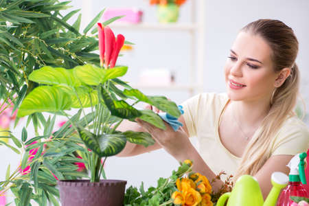 Young woman watering plants in her garden Stockfoto