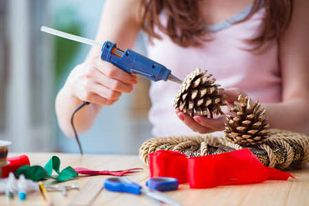 Woman doiing DIY festive decorations at home Banco de Imagens - 102500780