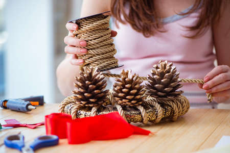 Woman doiing DIY festive decorations at home 写真素材