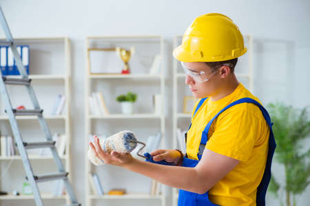 Painter working at home in refurbishment project Stock Photo