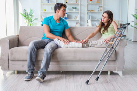 Husband man supporting injured wife Stock Photo