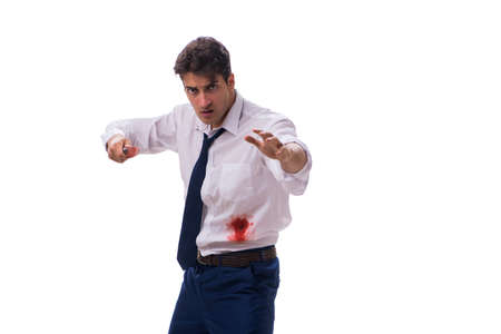 Wounded businessman with blood stains isolated on white backgrou Фото со стока