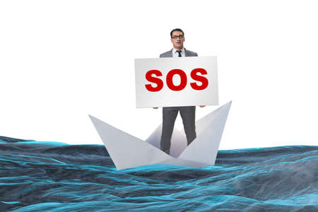 Businessman asking for help with SOS message on boat Фото со стока