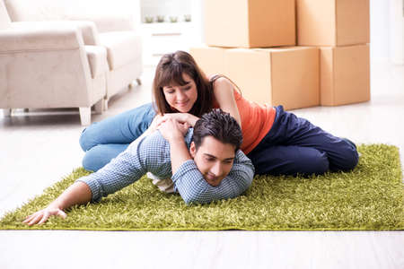 Young family moving to new house after final payment Stock Photo