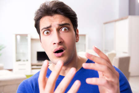 Man panicking because of pimples on the skin