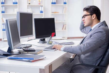 Businessman sitting in front of many screens Zdjęcie Seryjne