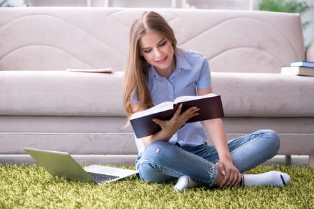 Young female student preparing for college exams Stock Photo