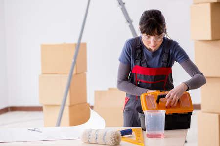 Woman preparing for wallpaper work