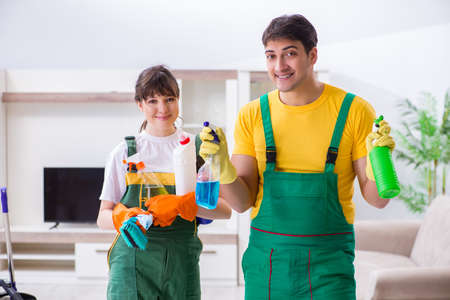 Cleaning professional contractors working at house