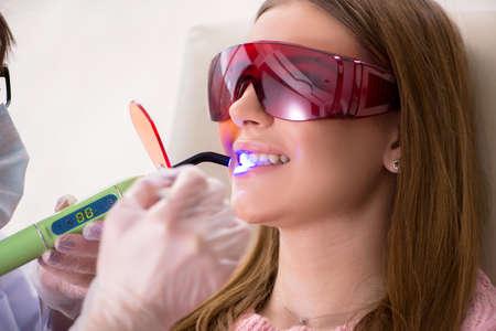 Patient visiting dentist for regular check-up and filling Stok Fotoğraf