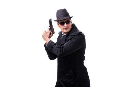 Man spy with handgun isolated on white background Reklamní fotografie - 103573414