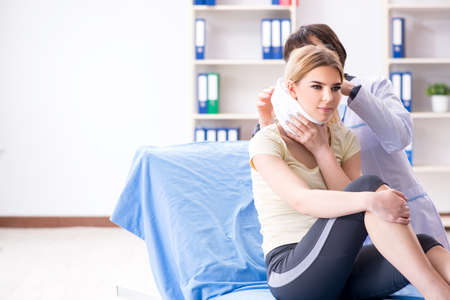 Doctor examining injured woman in hospital Stock Photo