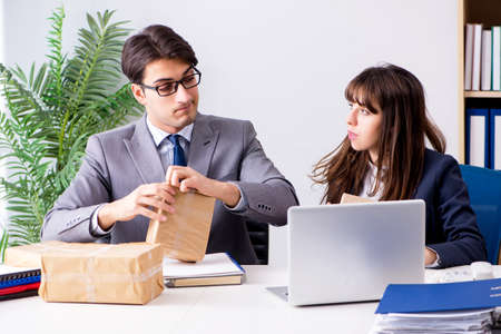Business people receiving new mail and parcels Фото со стока