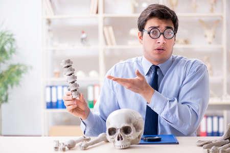Funny crazy professor studying human skeleton Stock Photo