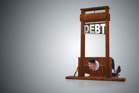 Businessman in heavy debt business concept Stock Photo