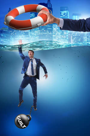 Businessman being saved from quilt Stock Photo