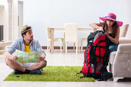 Young pair planning their honeymoon camping trip