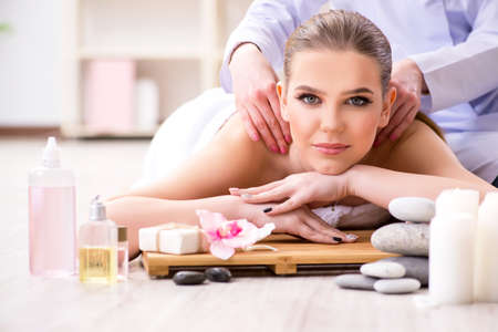 Young woman during spa procedure in salon 写真素材