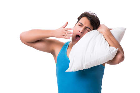 Young man with pillow isolated on white background