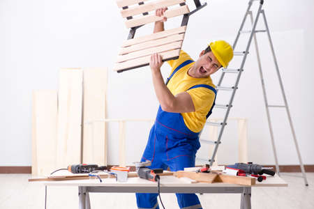 Floor repairman disappointed with his work Stock Photo