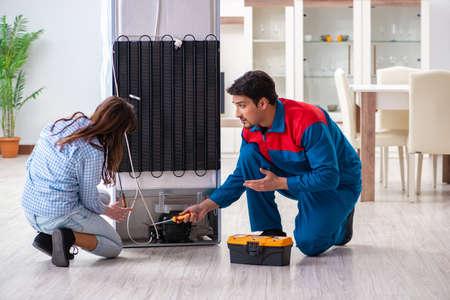 Man repairing fridge with customer Stock fotó