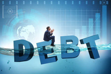 Businessman in debt business concept Banque d'images