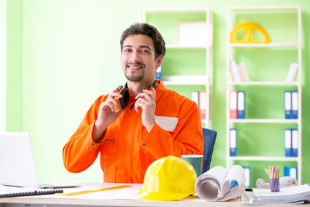 Construction supervisor planning new project in office Stock Photo