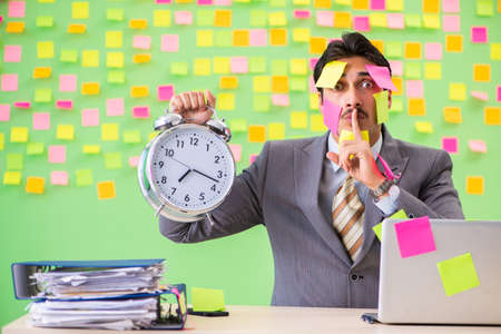Businessman with many conflicting priorities in time management Foto de archivo