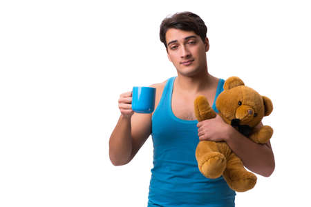 Young man with coffee cup isolated on white